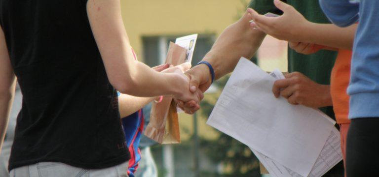 Student and teacher shaking hands